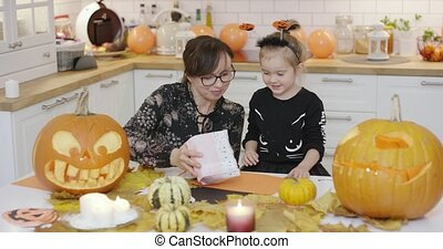 Mother giving daughter sweets - Happy little girl in cute...