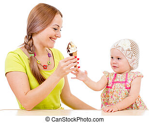 mother giving ice cream to little girl sitting at table isolated on white