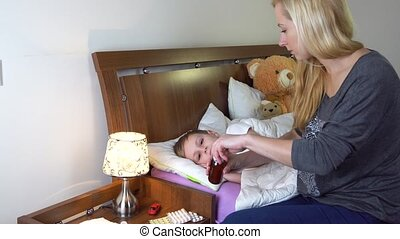 mother giving medicine to her sick kid
