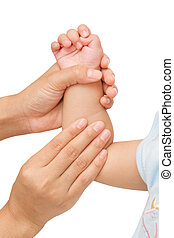 Mother hand massaging forearm of her baby
