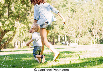 Mother having a walk with her son in the park
