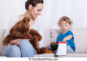 Mother having fun with baby