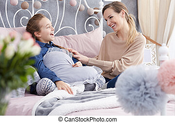 Mother having fun with daughter