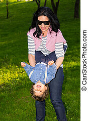 Mother having fun with toddler in park