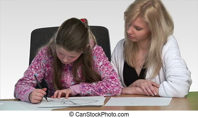 Mother heling her child with homework