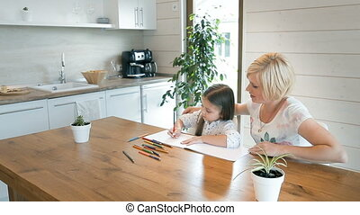 Mother Helps Daughter to Draw