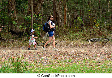 Mother hike with her infant baby and child