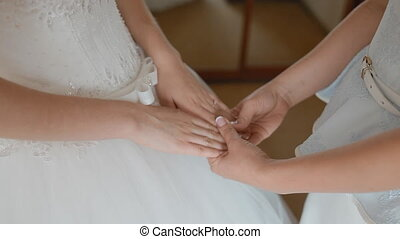 Mother hold hands of her daughter