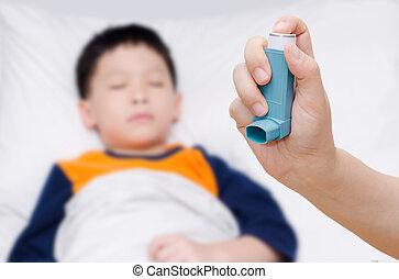 Mother holding asthma inhaler