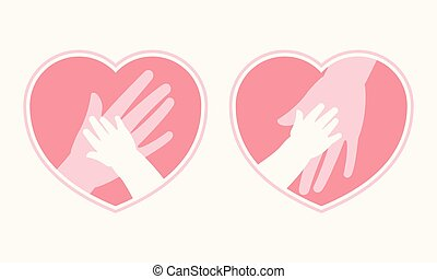 Mother holding baby hand in heart shaped symbol