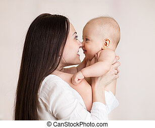 Mother holding baby son with love