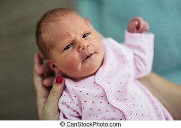 Mother holding beautiful little newborn