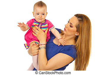 Mother holding crying baby