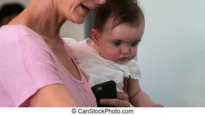 Mother Holding Her Baby Girl - Mother holding her little...