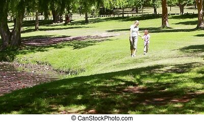Mother holding her daughter's hand while walking