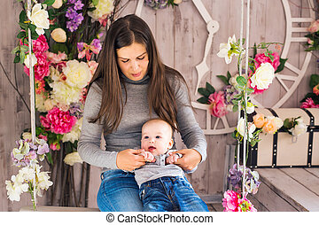 Mother holding sweet baby boy