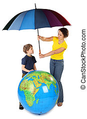 mother holding umbrella under big inflatable globe and her son, isolated on white