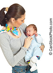 Mother holding yawning baby