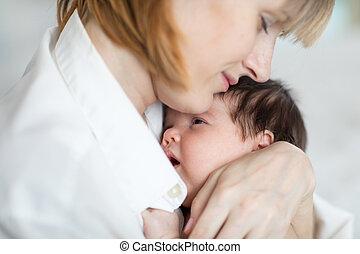 Mother hugging baby