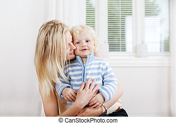 Mother hugging child - Young beautiful mother hugging baby ...