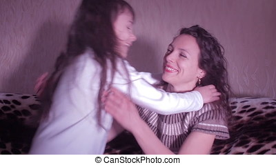 Mother hugging children. Happy family embraces.