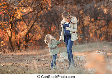 Mother hugging her child during walk in the park