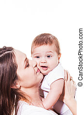 Mother hugs her baby isolated