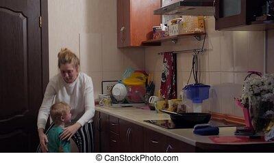 Mother Hugs Little Son