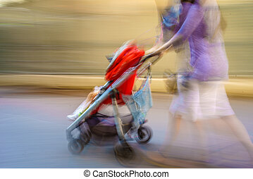 Mother in a NYC rush! - A blur of a mother pushing her...