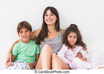 Mother in bed with children