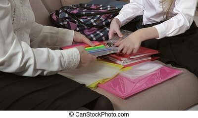 Mother In Bedroom Helping daughter To choose right pencils for School