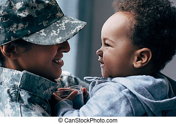 mother in military uniform with son