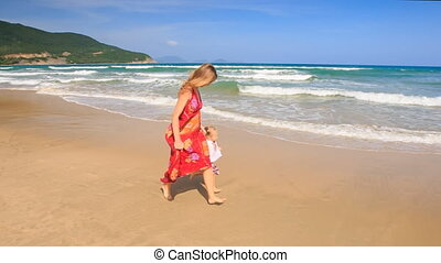 Mother in Red Little Girl Join Hands Run by Foamy Surf