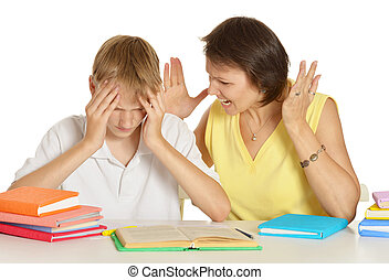 Mother is angry at her son doing homework