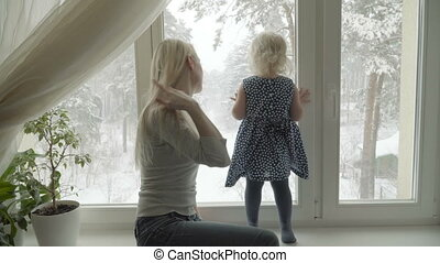 Mother is showing the winter landscape