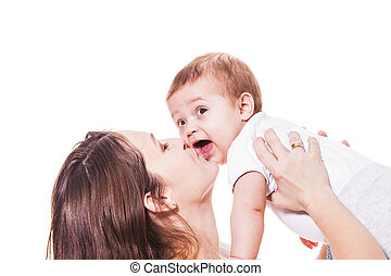 Mother kisses baby isolated