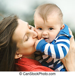 Mother kisses her son