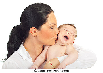Mother kissing baby boy