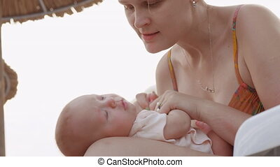 Mother kissing beloved baby daughter - Slow motion shot of...