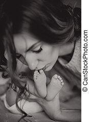 mother kissing feet