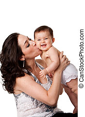 Beautiful mother kissing happy smiling laughing baby on cheek, isolated.