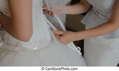 Mother lace the wedding dress of the bride