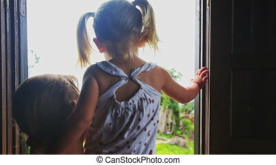 Mother Lifts in Arms Blond Girl Shows Hill out of Window