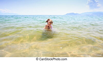 Mother Little Daughter Swim Play in Azure Transparent Sea