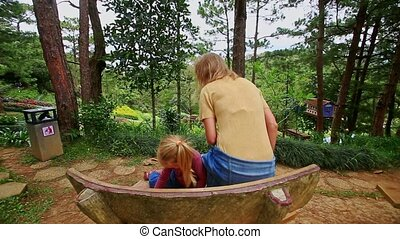 Mother Little Girl Come to Wooden Bench Take Seat in Park