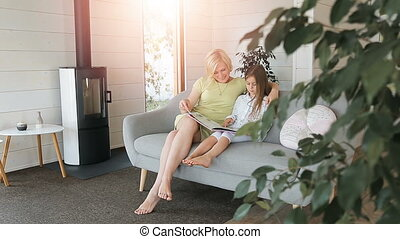 Mother Looking at Book Pictures with Daughter