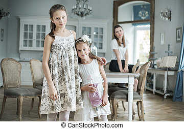Mother looking at her two cute daughters