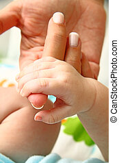 Mother love - Mother holding her baby's hand