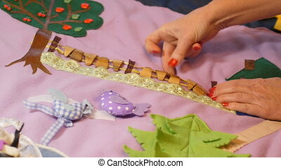 Mother makes soft creative mat for development of child at...