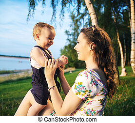 Mother making her child laughing